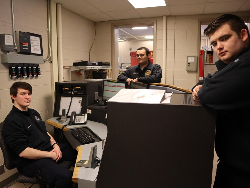 From left, Cameron O'Neil, John Mollevik and Brendan Martin stop in the dispatch roomFriday, Feb. 7, 2020, at the Maynard Firehouse in Marcy. The SUNY Polytechnic Institute students volunteer with the fire department in exchange for housing.