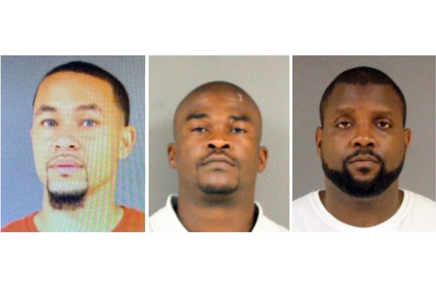 Officers Desmond Barney, Vincent Lampley and Anthony Fox (left to right) have been indicted on second-degree murder charges in the death of George Robinson in January of 2019.