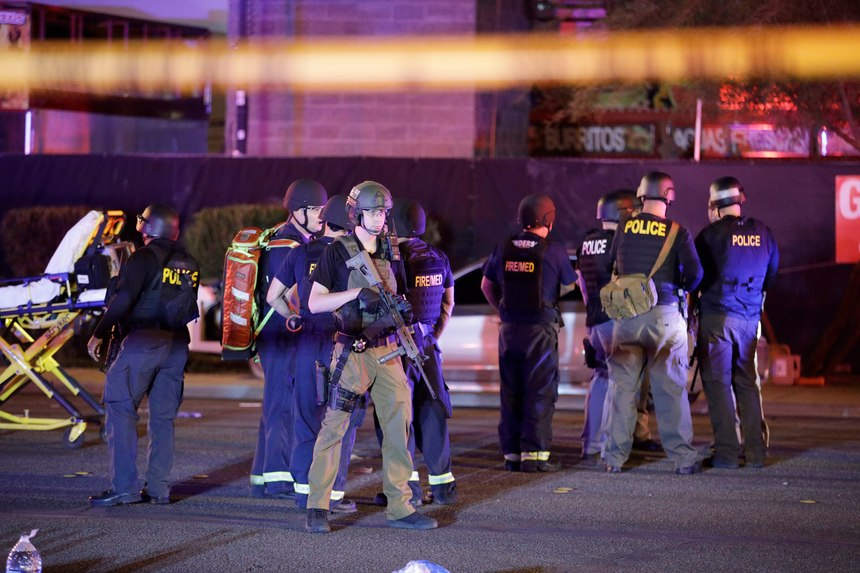 Police officers and medical personnel stand at the scene of a shooting near the Mandalay Bay resort and casino on the Las Vegas Strip on Oct. 2, 2017, in Las Vegas.
