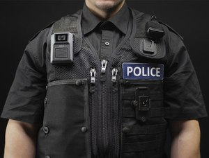 The new Axis body worn camera system features three main hardware components: the camera itself; the camera docking station (8-bay or 1-bay); and the system controller. (Photo/Axis Communications)