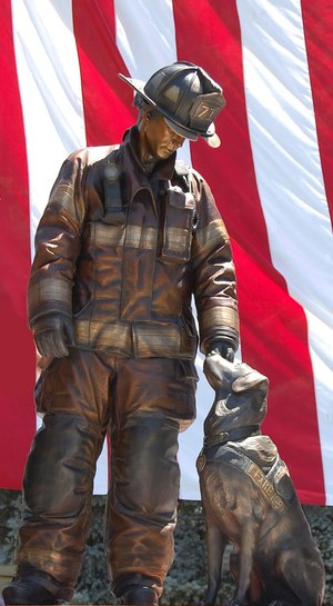 """One of Weishel's projects, """"Ashes to Answers,"""" portrays a life-size firefighter with an arson dog. The sculpture is located at Fire Station #2 in downtown Washington, DC. This sculpture was voted the most popular monument in Washington, DC in a 2014 Washington Post poll."""