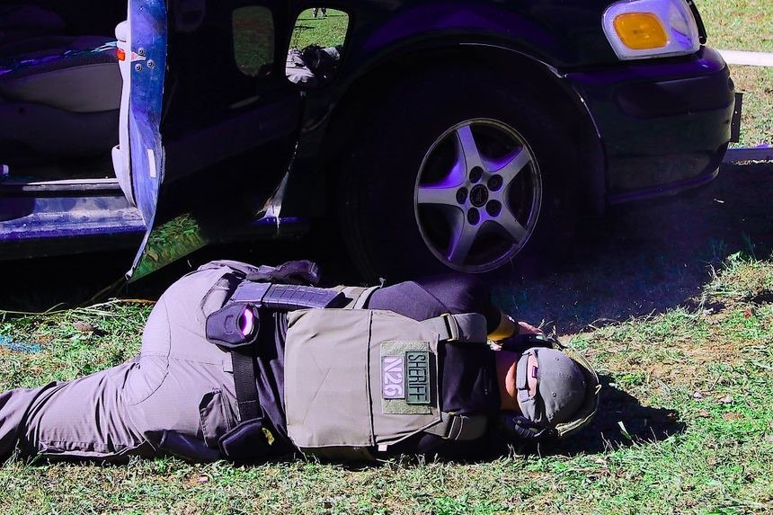 Training on vehicle cover techniques must emphasize exposing the smallest amount of the body possible. (Photo/Warren Wilson)