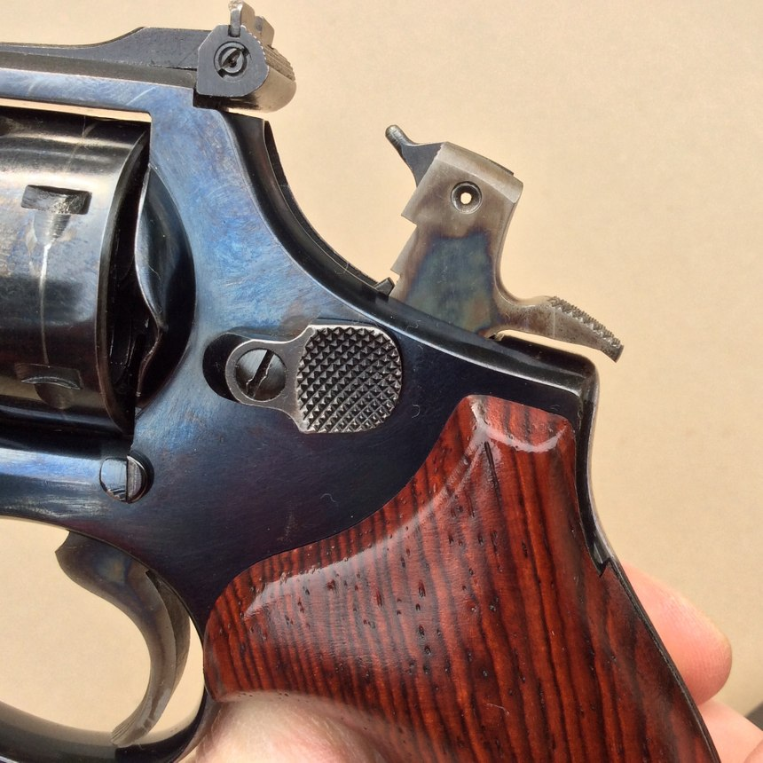 If the hammer is cocked, it needs to be safely lowered before the revolver can be unloaded. Use caution here, as it doesn't take much pressure on the trigger to make the gun fire in single-action mode. (Photo/Mike Wood)