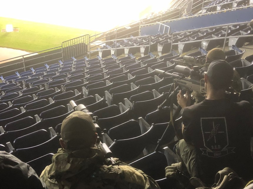 Getting stable while shooting from cramped conditions in the stadium can be a challenge. (Photo/Mike Wood)