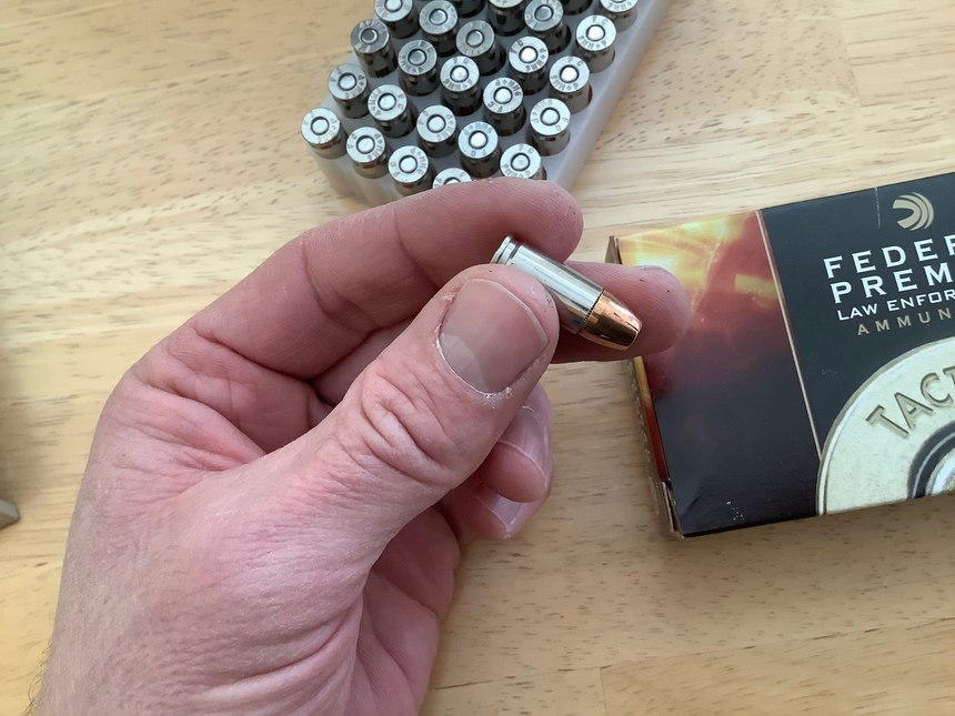The final inspection is tactile and visual, as you handle each cartridge prior to loading it in the magazine. (Photo/Mike Wood)