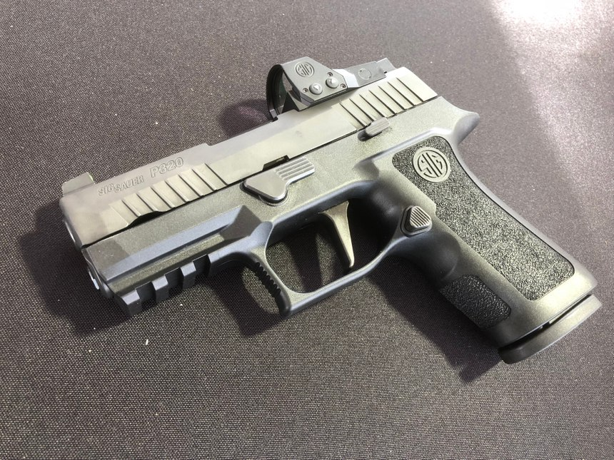 The Sig P320 RXP XCompact combines the upgraded X Features with the ROMEO1 PRO reflex sight. (Photo/Mike Wood)