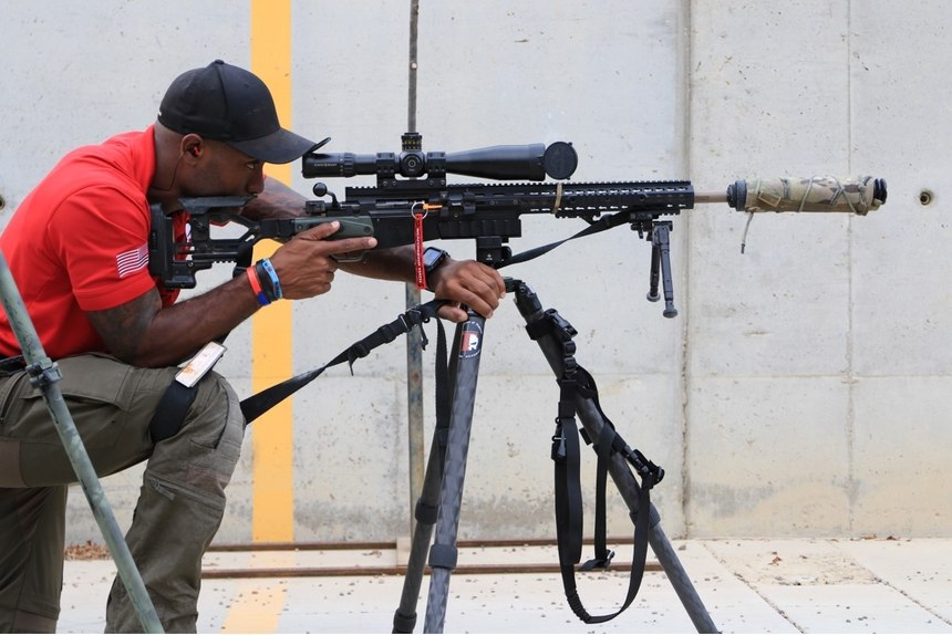 A TACFLOW Academy instructor demonstrates the flexibility of the modular, multi-caliber rifle concept, with an Accuracy International AXMC rifle outfitted as a .308 Winchester.