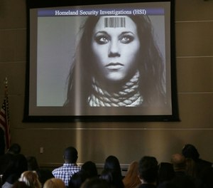 In this Tuesday, Jan. 12, 2016 photo, members of the industry group Club Owners Against Sex Trafficking attend a presentation by a U.S. Department of Homeland Security agent teaching owners of strip clubs and strippers how to spot sex traffickers, at the Burbank Community Services Building in Burbank, Calif.