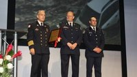 Firefighter honored for 'extraordinary rescue efforts' at FRI
