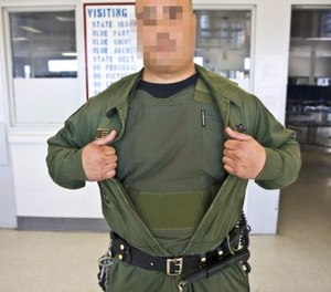 An officer displays a newly re-issued stab and ballistic vest. These vests are worn by all of the officers at the R.J. Donovan Correctional Facility.