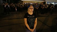 19-year-old girl shields Ferguson police from protesters