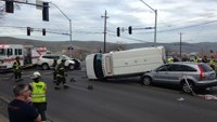 Four injured, including 2 EMTs, in 3-vehicle collision