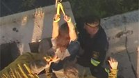 Firefighters rescue woman stuck in chimney