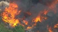 4 firefighters injured battling Mass. mill fire