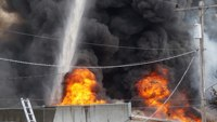 Fire burns Wash. metal plant, prompts chemical concerns