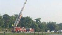 Semi hits parked fire truck, kills 1, injures 1