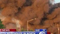Firefighters battling massive 5-alarm warehouse fire