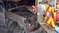 Driver slams SUV into fire truck, police car