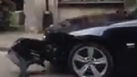 Fire truck rips off BMW's bumper getting to fire