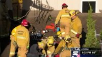 Firefighters rescue burglar stuck in chimney