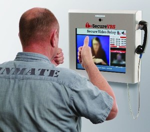 An inmate using secured video relay.