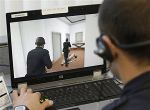 Sacramento Police Officer Vance Chandler moves his virtual character through a hallway while using a new computerized training system in Sacramento, Calif., Wednesday, Nov. 20, 2013. (AP Photo/Rich Pedroncelli)