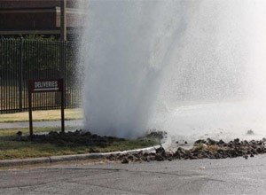 A major water main break caused water to shoot about 40 feet into the air around 9:15 a.m. Thursday near S.E. 9th and Jefferson on the south side of the Shawnee County Jail. (Photo Phil Anderson/The Capital-Journal)